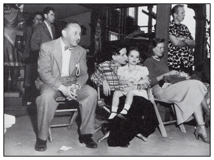 Arthur Freed, Judy Garland, and Liza Minnelli on the set of AnnieGet Your Gun